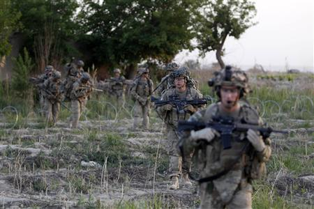 US soldiers from 5-20 infantry Regiment attached to 82nd Airborne walk while on patrol in Zharay district in Kandahar province, southern Afghanistan April 24, 2012. REUTERS/Baz Ratner