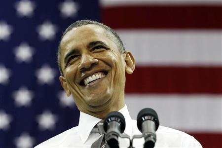 U.S. President Barack Obama smiles while talking about the rising costs of student loans in Carmichael Arena at the University of North Carolina at Chapel Hill April 24, 2012. REUTERS/Larry Downing