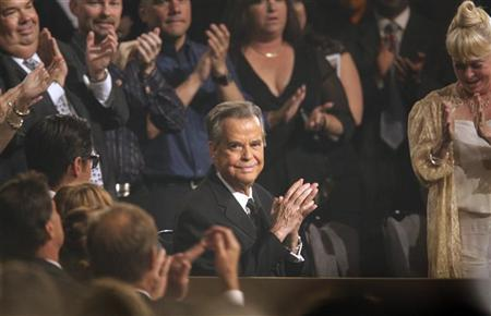 Dick Clark (C) receives a standing ovation as he is honored during the 37th Annual Daytime Emmy Awards show at the Las Vegas Hilton June 27, 2010. REUTERS/Steve Marcus