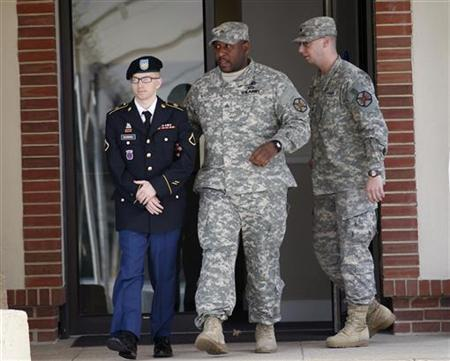 Army Pfc. Bradley Manning (L) leaves the courthouse after his motion hearing at Fort Meade in Maryland March 15, 2012. REUTERS/Jose Luis Magana