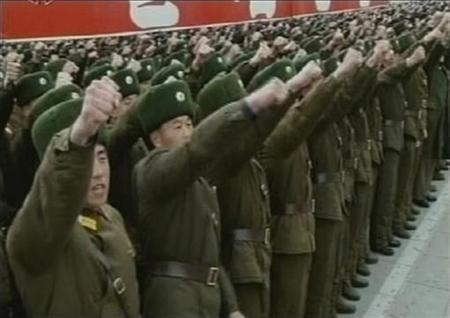 Soldiers take part in an anti-South Korea rally in Pyongyang in this still image taken from video broadcast by North Korean state TV on March 4, 2012. North Korea threatened ''sacred war'' against the South in a huge rally in the capital on Sunday just days after the secretive state agreed with the United States to suspend its nuclear weapons tests and allow back international nuclear inspectors. REUTERS/KRT via REUTERS TV