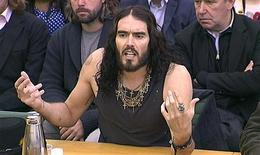 Comedian and actor Russell Brand is seen addressing the House of Commons Home Affairs Committee in a still image taken from video in central London April 24, 2012. Brand told the British government on Tuesday that it needs to adopt a pragmatic approach to address the social issues that lead young people to take drugs. REUTERS/Parbul TV via Reuters TV