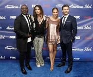 "Judges Randy Jackson (L), Steven Tyler (2nd L), Jennifer Lopez and show host Ryan Seacrest pose at the party for the finalists of the television show ""American Idol"" in Los Angeles, California March 1, 2012. REUTERS/Mario Anzuoni"