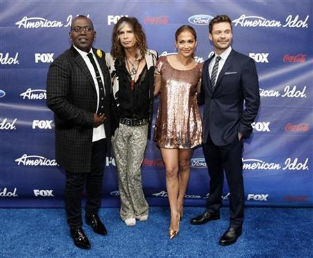 Judges Randy Jackson (L), Steven Tyler (2nd L), Jennifer Lopez and show host Ryan Seacrest pose at the party for the finalists of the television show ''American Idol'' in Los Angeles, California March 1, 2012. REUTERS/Mario Anzuoni