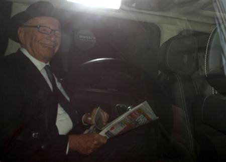 The Chairman and CEO of News Corporation, Rupert Murdoch, is driven away from his home in central London April 23, 2012. REUTERS/Andrew Winning
