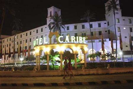 Prostitutes walk in front of the Hotel Caribe in Cartagena April 17, 2012. REUTERS/Stringer