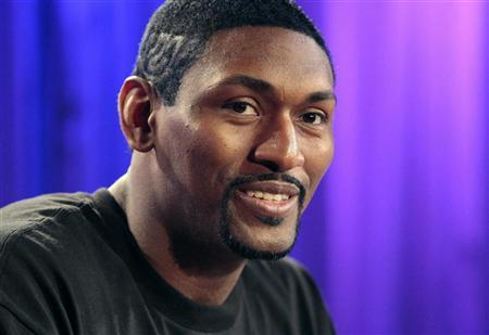 Los Angeles Lakers' Metta World Peace, formerly known as Ron Artest, smiles during a news conference in Los Angeles, California September 21, 2011. REUTERS/Jason Redmond