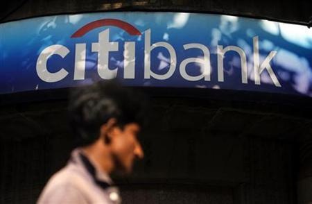 A man walks in front of a Citibank branch in Mumbai November 20, 2008. REUTERS/Arko Datta/Files