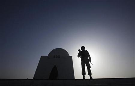A paramilitary personnel is silhouetted against the sun as he stands guard during a ceremony to mark the country's Pakistan Day (Resolution Day) celebrations at the mausoleum of Mohammad Ali Jinnah in Karachi March 23, 2012. REUTERS/Athar Hussain