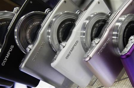 Olympus digital cameras are displayed at an electronics shop in Tokyo October 25, 2011. REUTERS/Yuriko NakaO/Files