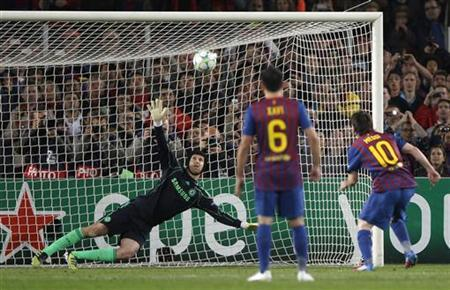 Barcelona's Lionel Messi (R) takes a penalty kick and ...