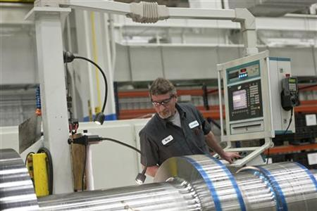 An employee with Siemens Energy works on a component for a turbine at Siemens Energy's plant in Charlotte, North Carolina January 25, 2012. REUTERS/Chris Keane/Files