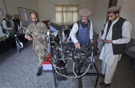 Men learn how to fix a vehicle engine in a classroom at the Mashal de-radicalisation centre run by the Pakistani army in Gulibagh, Pakistan's Swat Valley April 13, 2012. REUTERS/Mian Khursheed