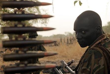 A South Sudan's army, or the SPLA, soldier sits in a truck on the frontline in Panakuach, Unity state,n April 24, 2012. REUTERS/Goran Tomasevic