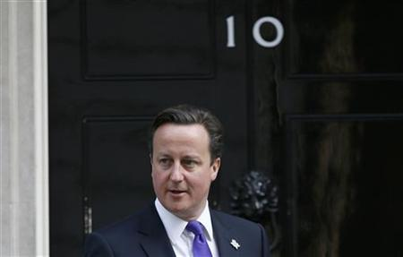 Britain's Prime Minister David Cameron waits at the door of 10 Downing Street for a meeting with International Olympic Committee president Jacques Rogge in London March 28, 2012. REUTERS/Chris Helgren