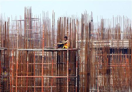 A labourer rests at the construction site of a residential complex on the outskirts of New Delhi February 25, 2010. REUTERS/Danish Siddiqui