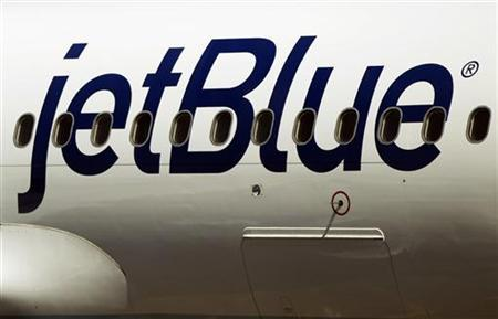 A JetBlue Airways plane awaits take off while at LaGuardia Airport in New York April 5, 2012. REUTERS/Lucas Jackson