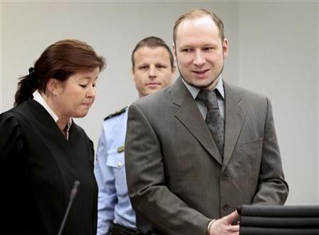 Norwegian anti-Muslim fanatic Anders Behring Breivik (R) smiles in a courtroom in Oslo April 25, 2012. REUTERS/Hakon Mosvold Larsen/NTB Scanpix/Pool