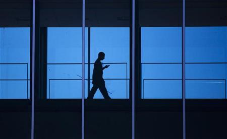 A student uses his mobile phone as he walks inside the Engineering building at the University of Waterloo, located beside the Blackberry maker's Research in Motion (RIM) headquarters in Waterloo April 18, 2012. REUTERS/Mark Blinch