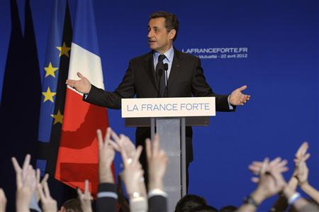 France's President and UMP party candidate for the 2012 French presidential elections Nicolas Sarkozy speaks to supporters at La Mutualite meeting hall in Paris after early results in the first round vote of the 2012 French presidential election April 22, 2012. REUTERS/Philippe Wojazer