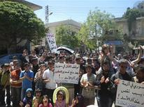 Demonstrators protest against Syria's President Bashar Al-Assad in Kafranbel, near Idlib April 24, 2012. REUTERS/Raad Al Fares/Shaam News Network/Handout