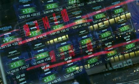 Stock prices on monitors are seen through a window to the street at the NASDAQ Market Site in New York's Times Square, March 13, 2012. REUTERS/Mike Segar