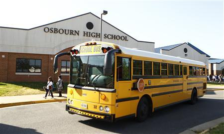 A bus pulls away from Osbourn High School in Manassas, Virginia, April 25, 2012. REUTERS/Kevin Lamarque