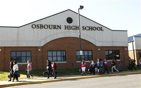Students pass in front of Osbourn High School in Manassas, Virginia, April 25, 2012.REUTERS/Kevin Lamarque