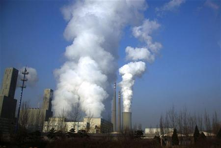 Smoke billows from the chimneys of a coal-burning power station in central Beijing March 15, 2012. REUTERS/David Gray
