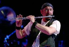 Ian Anderson, flautist and vocalist of the classic rock band Jethro Tull, performs during a rock concert at Fort Manoel in Valletta's Marsamxett Harbour August 1, 2004. REUTERS/Darrin Zammit Lupi