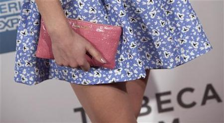 The purse of actress Emma Watson is seen as she arrives for the world premiere of ''Struck by Lightning'' as part of the Tribeca Film Festival in New York April 21, 2012. REUTERS/Andrew Kelly