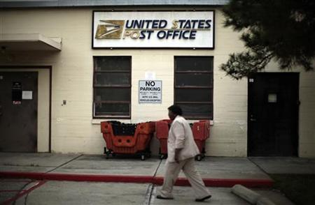A woman walks past a post office which closed its counter services four years ago at the Veterans Administration in Los Angeles, California January 30, 2012. REUTERS/Lucy Nicholson