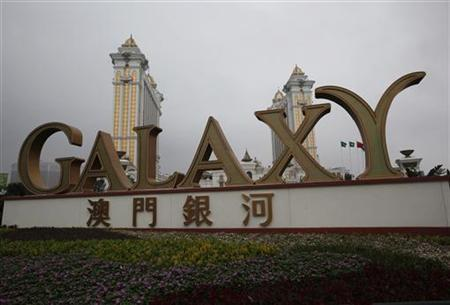 A Galaxy Entertainment Group sign is displayed outside Galaxy Macau, the latest resort in Macau, during its opening May 15, 2011. REUTERS/Bobby Yip