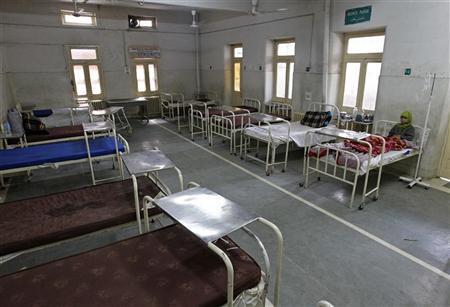 A patient rests on a bed inside a hospital in Srinagar April 13, 2010. REUTERS/Fayaz Kabli/Files
