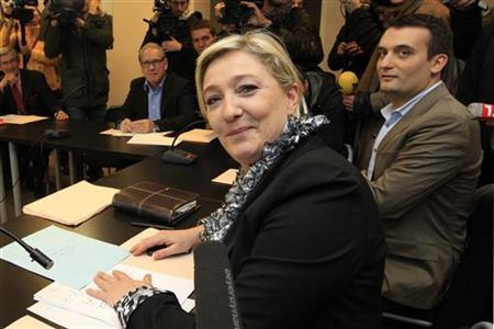 France's far right National Front party leader Marine Le Pen and her campaign director Florian Philippot (R) attend a meeting at their party's headquarters in Nanterre, near Paris, April 23, 2012 the day after the first round of the 2012 French presidential election. REUTERS/Pascal Rossignol