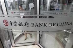 A woman leaves a branch of Bank of China in Beijing July 6, 2011. REUTERS/Jason Lee