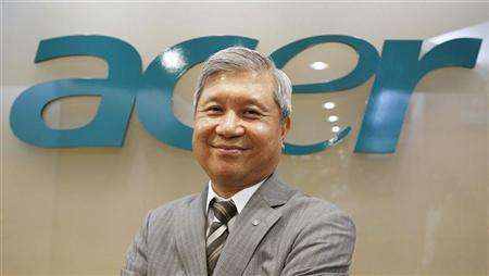 Acer's Chairman J.T. Wang poses for a photo after an interview with Reuters in Taipei December 14, 2010. REUTERS/Pichi Chuang