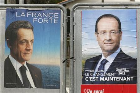 Official campaign posters for French President and UMP political party candidate Nicolas Sarkozy (L) and Socialist Party candidate Francois Hollande are displayed on electoral panels, days before the second round vote of the 2012 French presidential election in Saint-Maixent-L'Ecole April 26, 2012. REUTERS/Benoit Tessier
