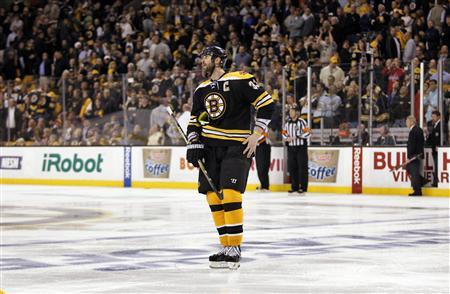 The Boston Bruins' Zdeno Chara reacts after losing to Washington Capitals in overtime in Game 7 of their NHL Eastern Conference quarter-final hockey playoff series in Boston, Massachusetts April 25, 2012. REUTERS/Jessica Rinaldi