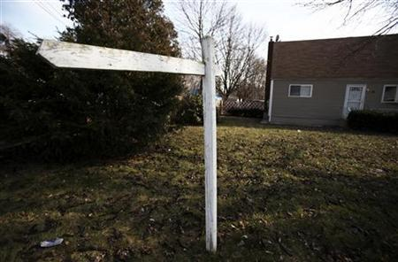 An empty post where a ''for sale'' sign used to hang is seen outside a home in Brentwood, New York February 10, 2012. REUTERS/Shannon Stapleton