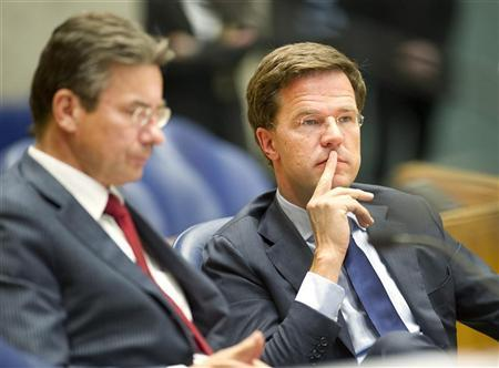 Netherlands' Prime Minister Mark Rutte (R) and Minister of Economic Affairs Maxime Verhagen attend a debate about the government's resignation caused by a crisis over budget cuts in The Hague April 24, 2012. REUTERS/Paul Vreeker/United Photos
