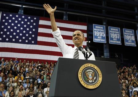 U.S. President Barack Obama waves before talking about the rising costs of student loans while in Carmichael Arena at the University of North Carolina at Chapel Hill April 24, 2012. REUTERS/Larry Downing
