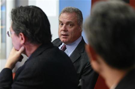 Mark Bertolini (C), President of Aetna, speaks at the Reuters Health Summit in New York, November 10, 2010. REUTERS/Brendan McDermid
