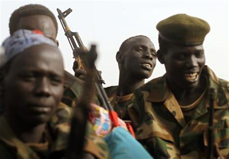 South Sudan's army, or the SPLA, soldiers ride in a truck on the frontline in Panakuach, Unity state, April 24, 2012. REUTERS/Goran Tomasevic