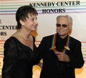 2008 Kennedy Center Honoree country singer George Jones holds hands with his wife Nancy as they arrive at the Kennedy Center for the Gala in Washington,December 7, 2008. REUTERS/Mike Theiler