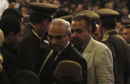 Presidential candidate Ahmed Shafiq (facing camera, L) attends the funeral of Pope Shenouda III, the head of Egypt's Coptic Orthodox Church, in the Abassiya Cathedral in Cairo March 20, 2012. REUTERS/Amr Abdallah Dalsh