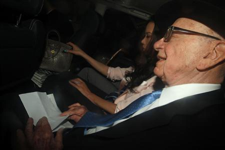 News Corporation Chief Executive and Chairman, Rupert Murdoch, leaves his apartment with his wife Wendi in London April 26, 2012. REUTERS/Andrew Winning