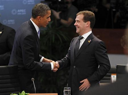 U.S. President Barack Obama (L) greets Russia's President Dmitry Medvedev as they meet at the start of the first plenary meeting during the APEC Summit in Honolulu, Hawaii November 13, 2011. REUTERS/Jason Reed