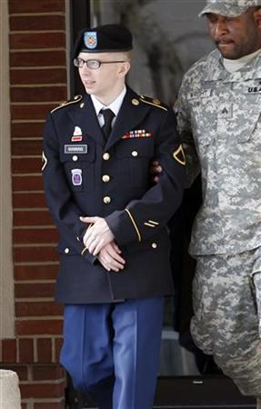 Army Pfc. Bradley Manning is escorted as he leaves the courthouse after his motion hearing at Fort Meade in Maryland March 15, 2012. REUTERS/Jose Luis Magana