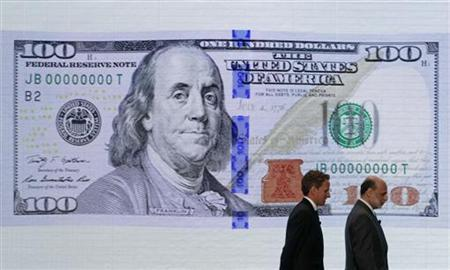 U.S. Treasury Secretary Timothy Geithner (L) and Federal Reserve Chairman Ben Bernanke leave a ceremony to debut the new design for the US$100 note at the Department of the Treasury in Washington, April 21, 2010. REUTERS/Jim Young